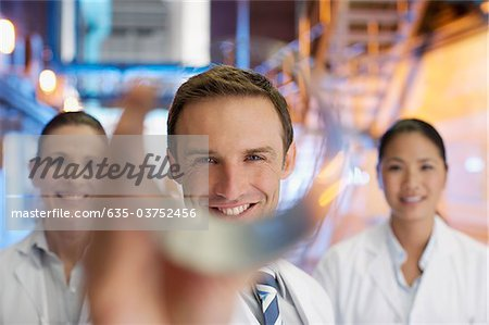 Scientists holding cylinder in factory Stock Photo - Premium Royalty-Free, Image code: 635-03752456