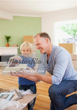 Father showing son model car in new house Stock Photo - Premium Royalty-Free, Image code: 635-03752574