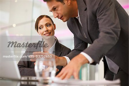 Business people working together on laptop Stock Photo - Premium Royalty-Free, Image code: 635-03752653