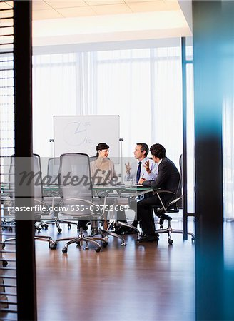 Business people working together in conference room Stock Photo - Premium Royalty-Free, Image code: 635-03752685