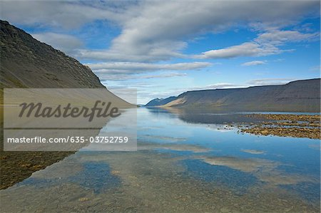 Hill and lake, Dynjandisvogur, Iceland Stock Photo - Premium Royalty-Free, Image code: 635-03752759