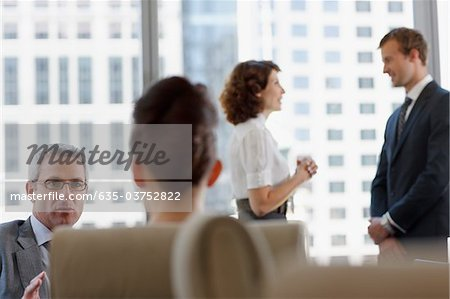 Business people working together in conference room Stock Photo - Premium Royalty-Free, Image code: 635-03752822
