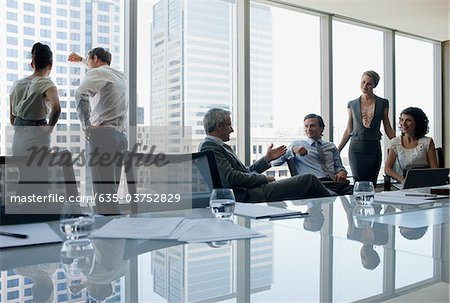 Business people working together in conference room Stock Photo - Premium Royalty-Free, Image code: 635-03752829