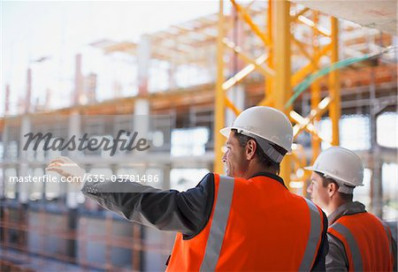 Construction workers working on construction site Stock Photo - Premium Royalty-Free, Image code: 635-03781486