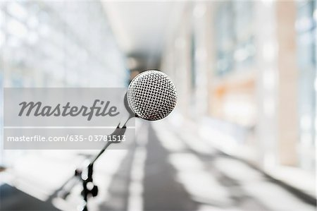 Close up of microphone in office Stock Photo - Premium Royalty-Free, Image code: 635-03781513