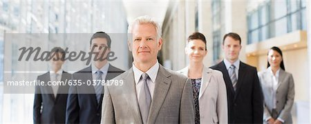 Business people standing together in office Stock Photo - Premium Royalty-Free, Image code: 635-03781789