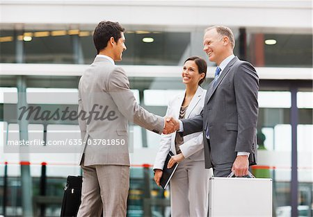 Businessmen shaking hands outdoors Stock Photo - Premium Royalty-Free, Image code: 635-03781850