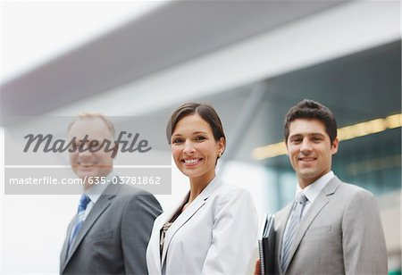 Business people standing together in office Stock Photo - Premium Royalty-Free, Image code: 635-03781862