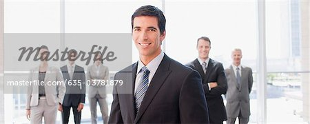 Business people standing together in office Stock Photo - Premium Royalty-Free, Image code: 635-03781879