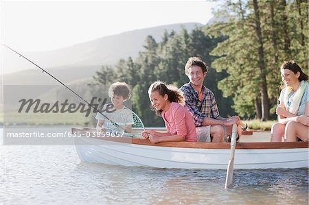 Family fishing in boat on lake Stock Photo - Premium Royalty-Free, Image code: 635-03859657