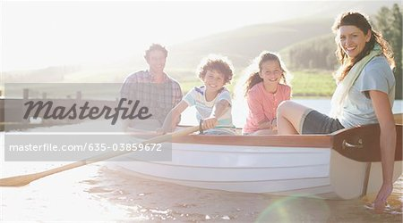 Family in rowboat on lake Stock Photo - Premium Royalty-Free, Image code: 635-03859672