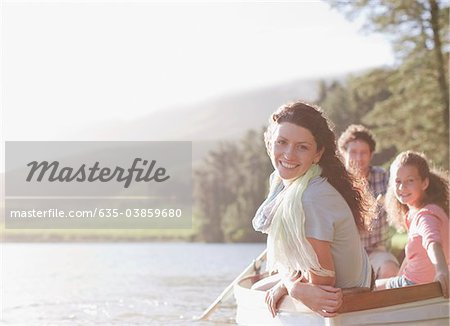 Family in rowboat on lake Stock Photo - Premium Royalty-Free, Image code: 635-03859680