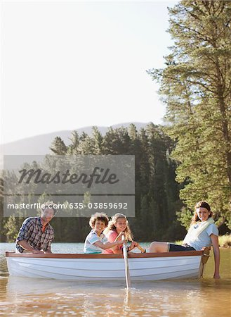 Family in rowboat on lake Stock Photo - Premium Royalty-Free, Image code: 635-03859692