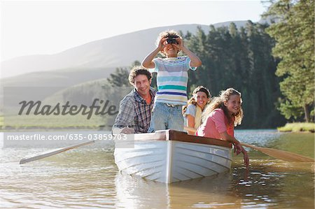 Family in rowboat on lake Stock Photo - Premium Royalty-Free, Image code: 635-03859703