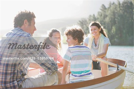Family in rowboat on lake Stock Photo - Premium Royalty-Free, Image code: 635-03859748