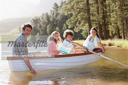Family in rowboat on lake Stock Photo - Premium Royalty-Free, Image code: 635-03859766