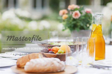 Food on table in garden Stock Photo - Premium Royalty-Free, Image code: 635-03859937