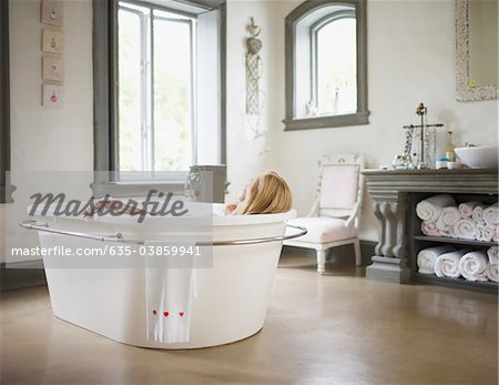 Woman in bathtub Stock Photo - Premium Royalty-Free, Image code: 635-03859941