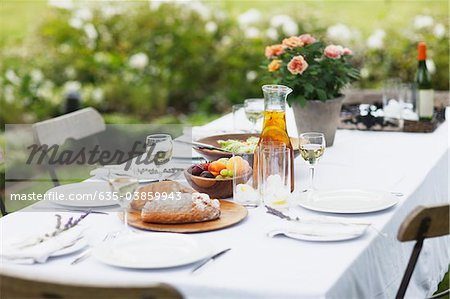 Food on table in garden Stock Photo - Premium Royalty-Free, Image code: 635-03859943