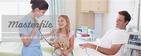 Nurse with father and daughter in hospital Stock Photo - Premium Royalty-Free, Image code: 635-03859969