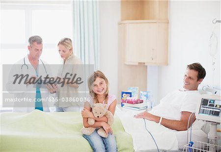 Patient with family and doctor in hospital Stock Photo - Premium Royalty-Free, Image code: 635-03860036