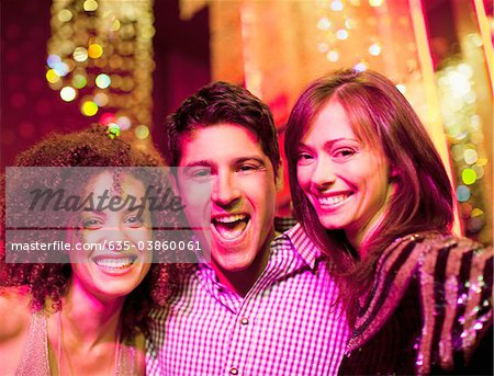 Portrait of friends at nightclub Stock Photo - Premium Royalty-Free, Image code: 635-03860061