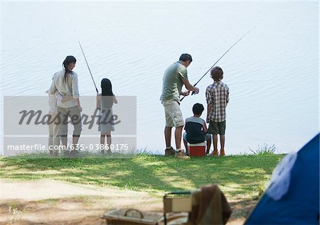 Family fishing near campsite Stock Photo - Premium Royalty-Free, Image code: 635-03860175