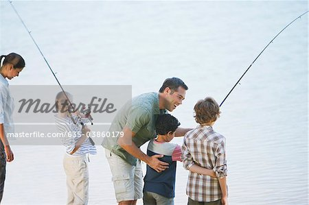Family fishing in lake Stock Photo - Premium Royalty-Free, Image code: 635-03860179