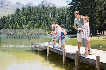 Family fishing off dock Stock Photo - Premium Royalty-Free, Image code: 635-03860189
