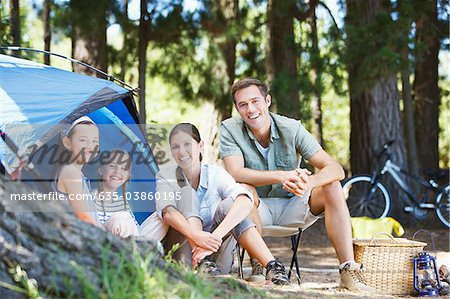 Family sitting outside tent at campsite Stock Photo - Premium Royalty-Free, Image code: 635-03860195