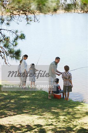 Family fishing lakeside Stock Photo - Premium Royalty-Free, Image code: 635-03860201