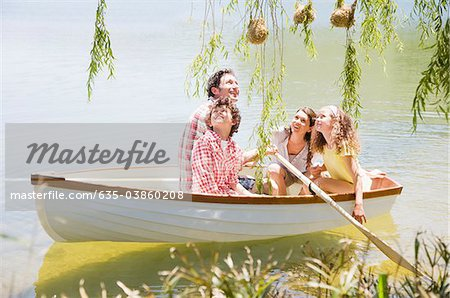 Family in rowboat on lake Stock Photo - Premium Royalty-Free, Image code: 635-03860208