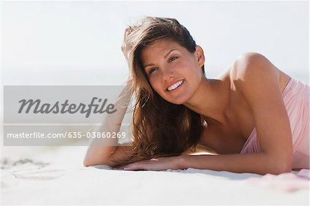 Woman laying on beach Stock Photo - Premium Royalty-Free, Image code: 635-03860269