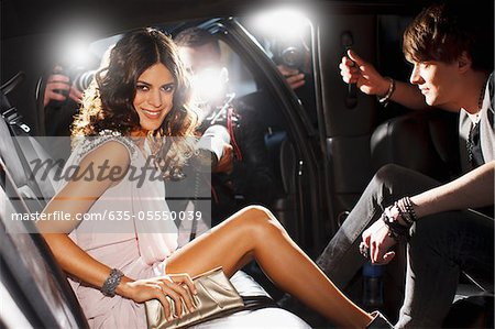 Celebrities emerging from car towards paparazzi Stock Photo - Premium Royalty-Free, Image code: 635-05550039