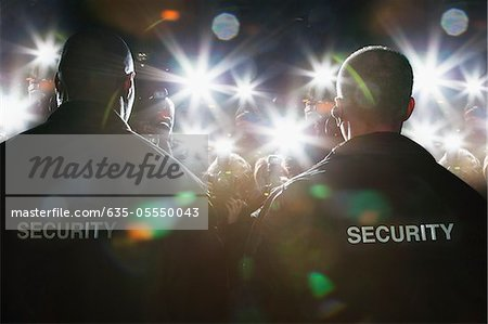 Security guards blocking paparazzi Stock Photo - Premium Royalty-Free, Image code: 635-05550043