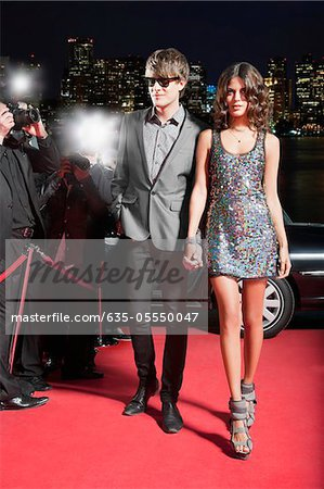 Celebrity walking on red carpet Stock Photo - Premium Royalty-Free, Image code: 635-05550047
