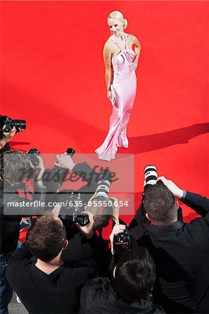 Celebrity posing for paparazzi on red carpet Stock Photo - Premium Royalty-Free, Image code: 635-05550054