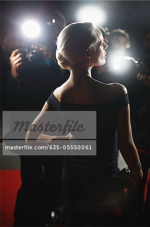 Celebrity posing for paparazzi on red carpet Stock Photo - Premium Royalty-Free, Image code: 635-05550061
