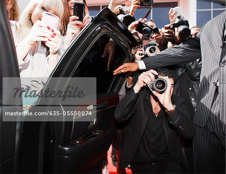 Paparazzi and fans taking photos inside car door Stock Photo - Premium Royalty-Free, Image code: 635-05550074