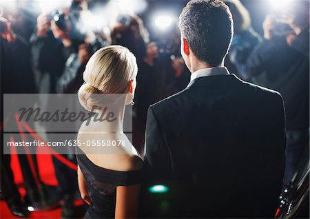 Celebrities posing for paparazzi on red carpet Stock Photo - Premium Royalty-Free, Image code: 635-05550076