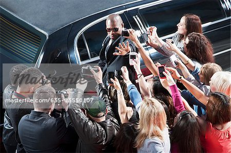 Bodyguard protecting celebrity from paparazzi Stock Photo - Premium Royalty-Free, Image code: 635-05550107