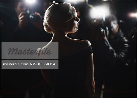 Celebrity posing for paparazzi Stock Photo - Premium Royalty-Free, Image code: 635-05550114