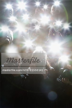 Paparazzi taking pictures with flash Stock Photo - Premium Royalty-Free, Image code: 635-05550141