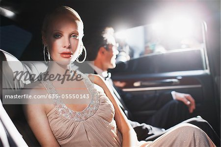 Celebrity sitting in backseat of car Stock Photo - Premium Royalty-Free, Image code: 635-05550143