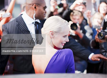 Bodyguard protecting celebrity on red carpet Stock Photo - Premium Royalty-Free, Image code: 635-05550169
