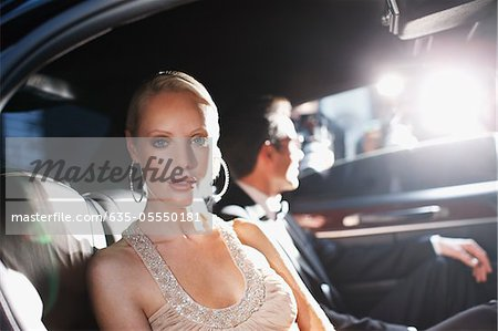 Celebrities posing for paparazzi in backseat of car Stock Photo - Premium Royalty-Free, Image code: 635-05550181