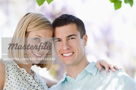 Couple smiling together outdoors Stock Photo - Premium Royalty-Free, Image code: 635-05550240