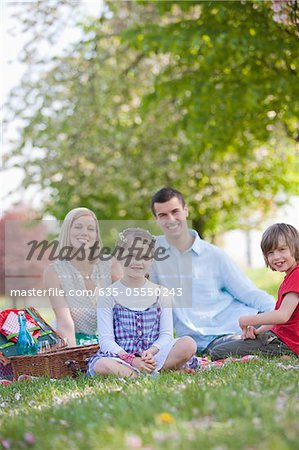 Family picnicking in park Stock Photo - Premium Royalty-Free, Image code: 635-05550243
