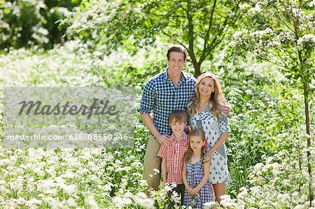 Family standing together in field of flowers Stock Photo - Premium Royalty-Free, Image code: 635-05550246