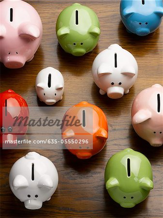 Multi-colored ceramic piggy banks Stock Photo - Premium Royalty-Free, Image code: 635-05550296
